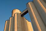 Grain elevators and warehouses along abandoned railroad tracks