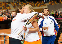 Februari 08, 2015, Apeldoorn, Omnisport, Fed Cup, Netherlands-Slovakia, Kiki Bertens (NED) is congratulated by captain Paul Haarhuis, she puts the Netherlands in the lead 2-1<br /> Photo: Tennisimages/Henk Koster