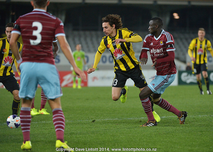 Cheikhou Kouyate tackles Alberto Riera during the Football United Tour match between Wellington Phoenix and West Ham United at Eden Park, Auckland, New Zealand on Wednesday, 23 July 2014. Photo: Dave Lintott / lintottphoto.co.nz