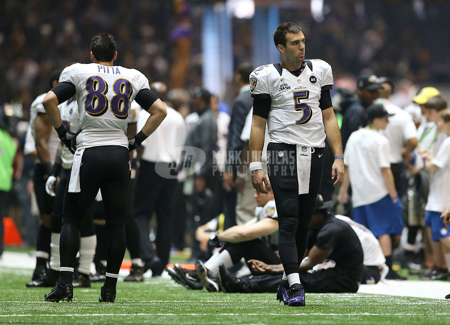 Feb 3, 2013; New Orleans, LA, USA; Baltimore Ravens quarterback Joe Flacco (5) on the field during the blackout delay against the San Francisco 49ers in Super Bowl XLVII at the Mercedes-Benz Superdome. Mandatory Credit: Mark J. Rebilas-