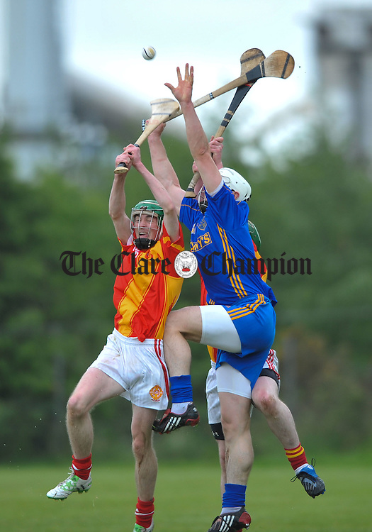 Mark O Halloran of Smith O Briens in action against Mark Flaherty of Killanena during their game at Scariff. Photograph by John Kelly.