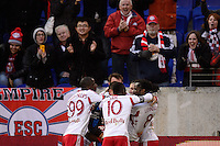 Peguy Luyindula (8) of the New York Red Bulls celebrates scoring the game tying goal with teammates. The New York Red Bulls and Chivas USA played to a 1-1 tie during a Major League Soccer (MLS) match at Red Bull Arena in Harrison, NJ, on March 30, 2014.