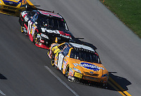 Apr 26, 2009; Talladega, AL, USA; NASCAR Sprint Cup Series driver Kyle Busch (18) leads teammate Denny Hamlin (11) during the Aarons 499 at Talladega Superspeedway. Mandatory Credit: Mark J. Rebilas-