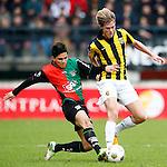 Nederland, Nijmegen, 3 februari 2013.Eredivisie .Seizoen 2012-2013.N.E.C.-Vitesse.Navarone Foor (l.) van N.E.C. en Tomas Kalas (r.) van Vitesse strijden om de bal.