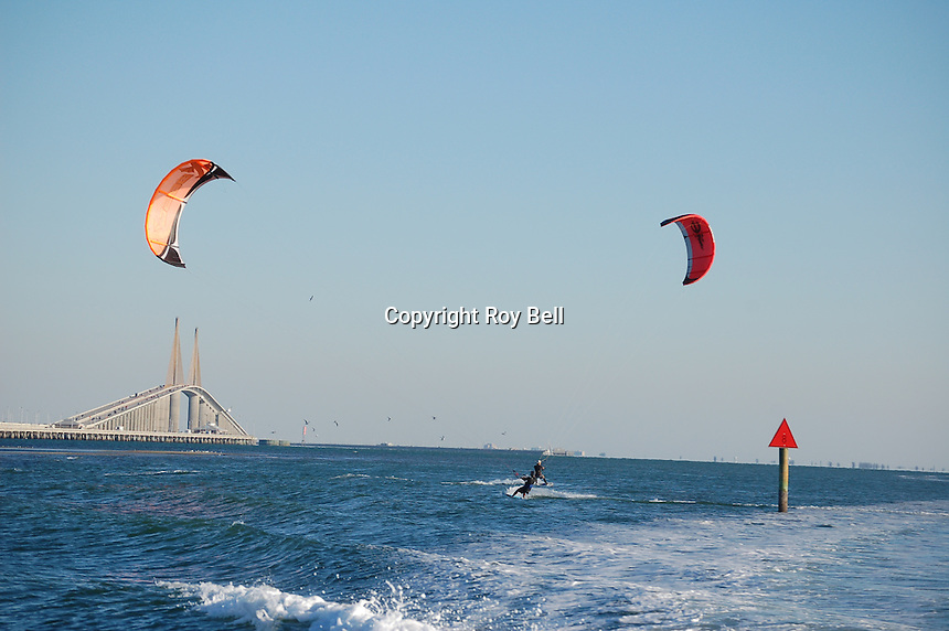 Two parasailers (one visible) sailing the wake of our boat in St. Peterberg, Florida's bay with bridge in background