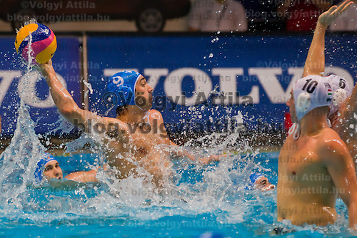 Italy's Christian Presciutti attacks against Hungary's Denes Varga and Norbert Hosnyanszky during the Volvo Water Polo Cup in Szekesfehervar, Hungary on January 07, 2012. ATTILA VOLGYI
