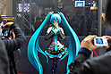 Tokyo, Japan - March 24: Visitors took pictures of a figure of Miku Hatsune, a virtual singer, at Tokyo International Anime Fair at Tokyo Big Sight, Koto, Tokyo, Japan on March 24, 2012. The fair was the largest animation exhibition in the world, and 216 companies had their booths to show their products.