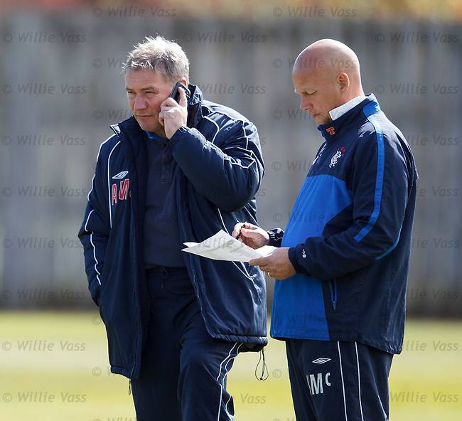 Ally McCoist on his phone at training