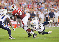 Aug. 22, 2009; Glendale, AZ, USA; Arizona Cardinals running back (31) Jason Wright breaks the tackle by San Diego Chargers linrbacker (99) Kevin Burnett during a preseason game at University of Phoenix Stadium. Mandatory Credit: Mark J. Rebilas-