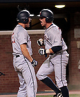 Virginia outfielder Joe McCarthy (31), left, celebrates with Virginia outfielder Derek Fisher (23) after both scored in the third inning during an NCAA college baseball regional tournament game against in Charlottesville, VA., Sunday, June 1, 2014. (Photo/Andrew Shurtleff)