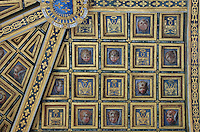 Carved and painted wooden ceiling of the Chapelle Haute Saint-Saturnin, begun 1540s under Francois I and decorated by Philippe Delorme, with angel portraits and initials H for Henri IV and M for Marie de Medici, at the Chateau de Fontainebleau, France. The chapel was built with 2 storeys, the upper section for the use of royalty. The Palace of Fontainebleau is one of the largest French royal palaces and was begun in the early 16th century for Francois I. It was listed as a UNESCO World Heritage Site in 1981. Picture by Manuel Cohen