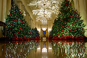 """The 2018 White House Christmas decorations, with the theme """"American Treasures"""" which were personally selected by first lady Melania Trump, are previewed for the press in Washington, DC on Monday, November 26, 2018.  This is the Cross Hall looking from the State Dining Room towards the East Room.  <br /> Credit: Ron Sachs / CNP"""