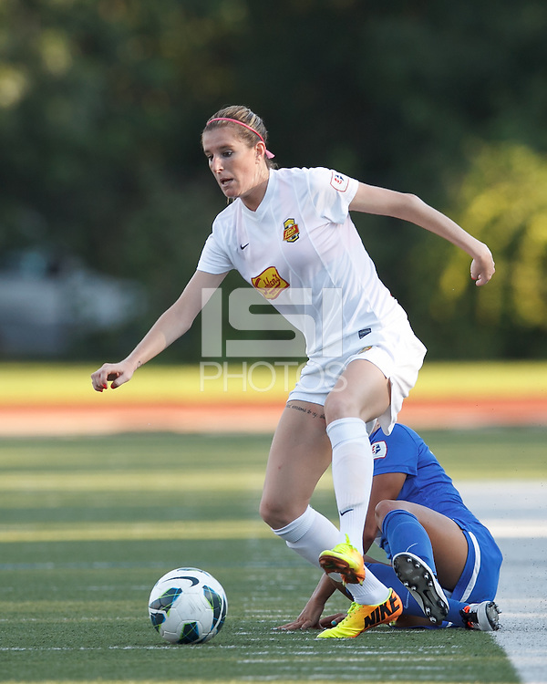 Western New York Flash forward Adriana Martin (8) eludes Boston Breakers defender and controls the ball. In a National Women's Soccer League (NWSL) match, Boston Breakers (blue) tied Western New York Flash (white), 2-2, at Dilboy Stadium on August 3, 2013.