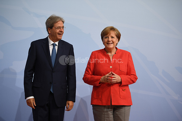 German chancellor Angela Merkel greets Paolo Gentiloni, the prime minister of Italy, at the G20 summit in Hamburg, Germany, 7 July 2017. The heads of the governments of the G20 group of countries are meeting in Hamburg on the 7-8 July 2017. Photo: Bernd Von Jutrczenka/dpa-pool/dpa /MediaPunch ***FOR USA ONLY***