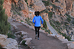 Female Grand Canyon trail runner descending the South Kaibab Trail in Grand Canyon, Arizona. . John offers private photo tours in Grand Canyon National Park and throughout Arizona, Utah and Colorado. Year-round.