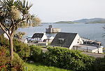 General view of Castlebay the largest settlement in Barra, Outer Hebrides, Scotland, UK looking towards Kisimul castle in the harbour