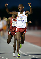 NWA Democrat-Gazette/ANDY SHUPE<br /> Arkansas' Gilbert Boit (center) celebrates Saturday, May 11, 2019, after passing Gilbert Kigen (left) of Alabama to win the 5,000 meters during the SEC Outdoor Track and Field Championships at John McDonnell Field in Fayetteville. Visit nwadg.com/photos to see more photographs from the meet.