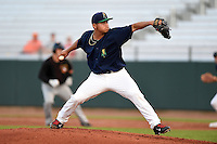 Cedar Rapids Kernels pitcher Chih-Wei Hu (40) delivers a pitch during a game against the Quad Cities River Bandits on August 18, 2014 at Perfect Game Field at Veterans Memorial Stadium in Cedar Rapids, Iowa.  Cedar Rapids defeated Quad Cities 4-2.  (Mike Janes/Four Seam Images)