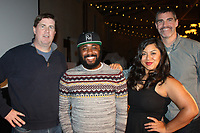 NWA Democrat-Gazette/CARIN SCHOPPMEYER Nathan Pendleton (from left), John Hurst, Stan Zylowski and Monica Kumar, Laughter and Libations game night contestants gather at the Trike Theatre benefit March 3 at the Barn at the Springs.