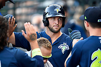 Designated hitter Tim Tebow (15) of the Columbia Fireflies is congratulated after scoring a run in a game against the Lexington Legends on Thursday, June 8, 2017, at Spirit Communications Park in Columbia, South Carolina. Columbia won, 8-0. (Tom Priddy/Four Seam Images)