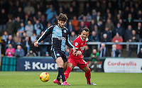 Joe Jacobson of Wycombe Wanderers holds off Calaum Jahraldo-Martin of Leyton Orient during the Sky Bet League 2 match between Wycombe Wanderers and Leyton Orient at Adams Park, High Wycombe, England on 23 January 2016. Photo by Andy Rowland / PRiME Media Images.