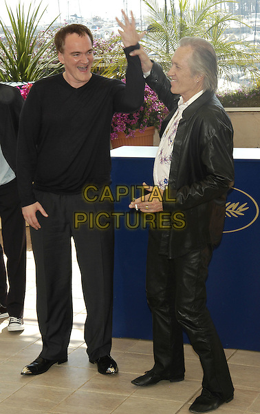 "QUENTIN TARANTINO & DAVID CARRADINE.Photocall for ""Kill Bill: Volume 2"".Cannes Film Festival, .France 16th May 2004..caradine full length full-length smoking cigarette funny pose gesture arm up.sales@capitalpictures.com.www.capitalpictures.com.©Capital Pictures.."