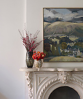 The marble fireplace in the living room is original to the Brooklyn brownstone house