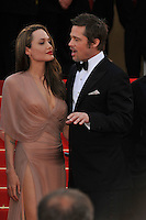 ANGELINA JOLIE &amp; BRAD PITT<br /> The &quot;Inglourious Basterds&quot; Premiere at the Grand Theatre Lumiere during the 62nd Annual Cannes Film Festival, Cannes, France.<br /> May 20th, 2009<br /> length half 3/4 dress sheer wrap beige pink cream black tuxedo couple goatee facial hair slit split thigh red lipstick hand profile mouth open<br /> CAP/PL<br /> &copy;Phil Loftus/Capital Pictures /MediaPunch ***NORTH AND SOUTH AMERICAS ONLY***