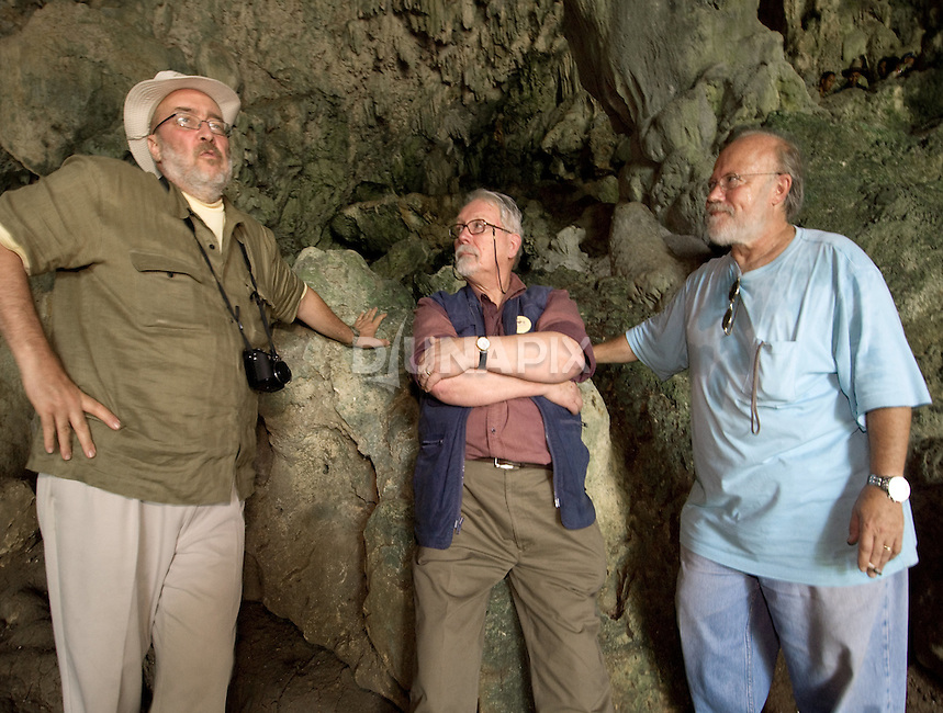 """Alan Thorne relects on Liang Bua Cave with colleagues at the discovery site of the Flores """"hobbit"""", Homo floresiensis"""