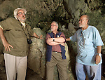 "Alan Thorne relects on Liang Bua Cave with colleagues at the discovery site of the Flores ""hobbit"", Homo floresiensis"