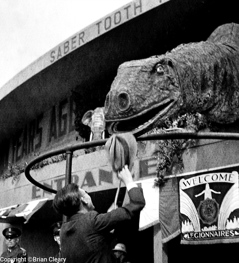 A fairgoer offers his hat to a dinosaur at the Sinclair Oil display at the 1933 Chicago World's Fair. (Photographer Unknown/www.bcpix.com)