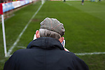 A home fan reading the match programme at Aggborough, home of Kidderminster Harriers before they played visitors Gainsborough Trinity in a National League North fixture. Harriers were formed in 1886 and have played at their current home since 1890. They won this match  by 3-0 watched by a crowd of 1465.