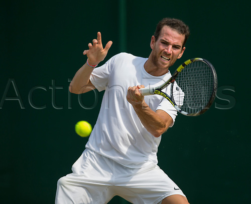 July 6th 2017, All England Lawn Tennis and Croquet Club, London, England; The Wimbledon Tennis Championships, Day 4; Adrian Mannarino (FRA) hits a forehand return to Yuichi Sugita (JPN)