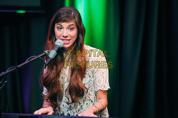 BALA CYNWYD, PA - FEBRUARY 24 :  Christina Perri visits MIX 106.1 performance theater in Bala Cynwyd, Pa on February 24, 2014 <br /> CAP/MPI/STA<br /> &copy;Star Shooter/MediaPunch/Capital Pictures