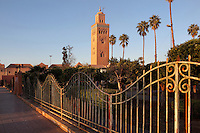 Gardens of the Koutoubia mosque, Medina, Marrakech, Morocco. The mosque was completed in the reign of the Almohad Caliph Yaqub al-Mansur, 1184-1199. The minaret stands 77m tall and is built of sandstone bricks, topped with copper orbs. It is the largest mosque in Marrakech. Picture by Manuel Cohen