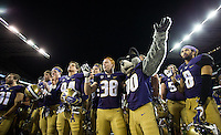 The Huskies celebrate a 44-18 win over the Sun Devils.