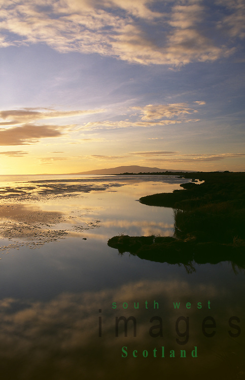 Scottish coast Sunset on the Solway Firth estuary at Powfoot near Annan looking up to Criffel Scotland UK