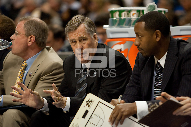 Mike Montgomery talks with assistant coach Travis DeCuire. The California Golden Bears defeated the UCLA Bruins 85-72 during the semifinals of the Pacific Life Pac-10 Conference Tournament at Staples Center in Los Angeles, California on March 12th, 2010.