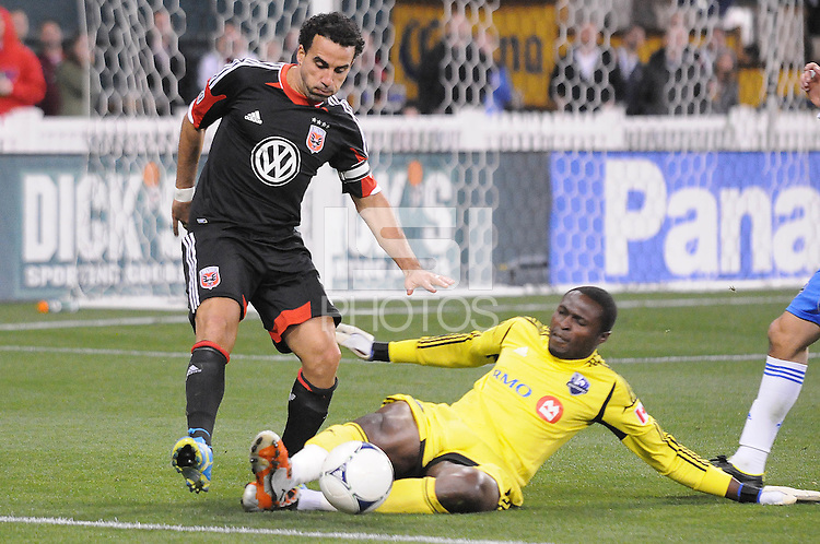 Montreal Impact goalkeeper Donovan Ricketts (1) goes against D.C. United forward Dwayne De Rosario (7)  D.C. United tied The Montreal Impact 1-1, at RFK Stadium, Wednesday April 18 , 2012.