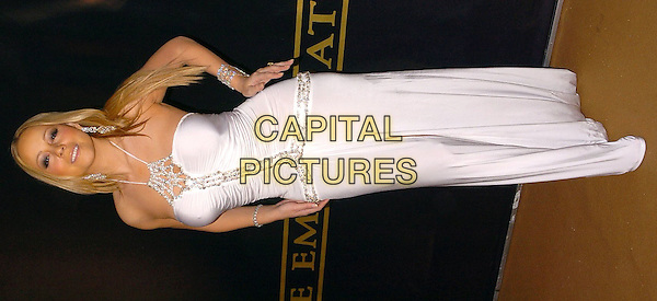 MARIAH CAREY.Arrives at her Birthday and Album Launch Party, Tantra, Kingly Street, London, .March 26th 2005..full length white silver diamante diamonds dress halterneck jewellery hands on hips.Ref: CAN.www.capitalpictures.com.sales@capitalpictures.com.©Can Nguyen/Capital Pictures