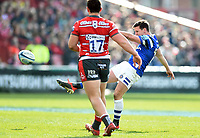 Freddie Burns of Bath Rugby drop-kicks the ball. Gallagher Premiership match, between Gloucester Rugby and Bath Rugby on April 13, 2019 at Kingsholm Stadium in Gloucester, England. Photo by: Patrick Khachfe / Onside Images