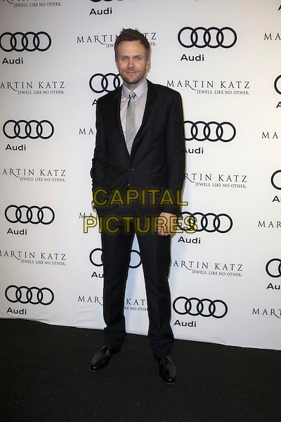Joel McHale.Audi And Martin Katz Kick Off Golden Globes Week 2012 Held At Cecconi's Restaurant, West Hollywood, California, USA..January 8th, 2012.full length grey gray shirt black suit hands in pockets.CAP/ADM/ES.©Emiley Schweich/AdMedia/Capital Pictures.