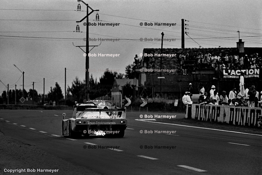 LE MANS, FRANCE:  The Joest Racing Porsche 936C JR005 driven by Bob Wollek, Jean-Michel Martin and Philippe Martin closes on slower traffic in the Mulsanne Corner during the 24 Hours of Le Mans on June 20, 1982, at Circuit de la Sarthe in Le Mans, France.