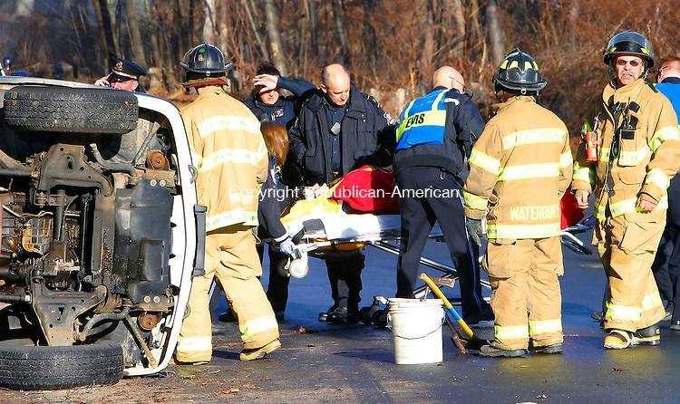 WATERBURY, CT. 12 March 2007--031207SV01--Medics and firefighters remove a patient from a over turned vehicle on Platts Mill Road in Waterbury Friday morning.<br /> Steven Valenti Republican-American