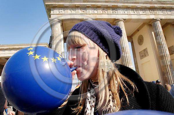 BERLIN - GERMANY 23. 3. 2007 -- EU celebrates its first 50 years. A girl blows a balloon with the EU logo in front of Berlin's landmark Brandenburger Gate -- PHOTO: GORM K. GAARE
