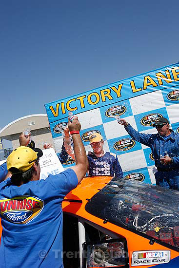 Tooele - Patrick Long, driver for AASCO Motorsports is doused by team members after he took first place at the Nascar Camping World Series Saturday, August 1 at Miller Motorsports Park..