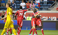 Chicago forward Dominic Oduro (8) gets a hug from teammate Dan Gargan (3) after scoring Chicago's second goal.  The Chicago Fire defeated the Columbus Crew 2-1 at Toyota Park in Bridgeview, IL on June 23, 2012.