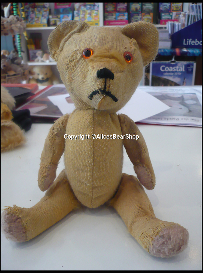BNPS.co.uk (01202 558833)<br /> Pic: AlicesBearShop/BNPS<br /> <br /> Teddy, Mant, after the surgery.<br /> <br /> Broken bears and deteriorating dolls from all over the world are being brought back to life by a UK team of dedicated doctors and nurses at one of the last remaining toy hospitals.<br /> <br /> The team at Alice's Bear Shop, a teddy bear and doll hospital in Lyme Regis, Dorset, perform all kinds of 'surgery' from simple restringing and re-stuffing to head re-attachments and complete skin grafts.<br /> <br /> Rikey Austin, 49, opened the hospital in January 2000 but also ran a shop and only repaired one or two toys a month.<br /> <br /> Now she has a four-month waiting list for patients and has had to close the shop to focus on the hospital side of the business.
