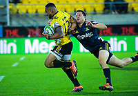 Ngani Laumape brushes off Ben Smith on his way to the tryline during the Super Rugby match between the Hurricanes and Highlanders at Westpac Stadium in Wellington, New Zealand on Friday, 1 March 2019. Photo: Dave Lintott / lintottphoto.co.nz