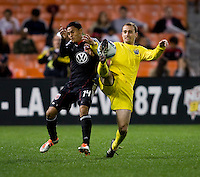 Andy Najar (14) of D.C. United has the ball cleared away from him by Rich Balchan (2) of the Columbus Crew during the home opener at RFK Stadium in Washington D.C.  D.C. United defeated the Columbus Crew, 3-1.